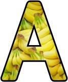 Free printable classroom display lettering sets with a banana background.