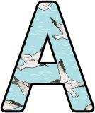 Free printable digital classroom display lettering with a Seagull cartoon background.